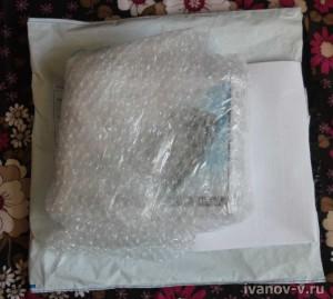упаковка посылки с умным зарядным устройством Kweller X-1800